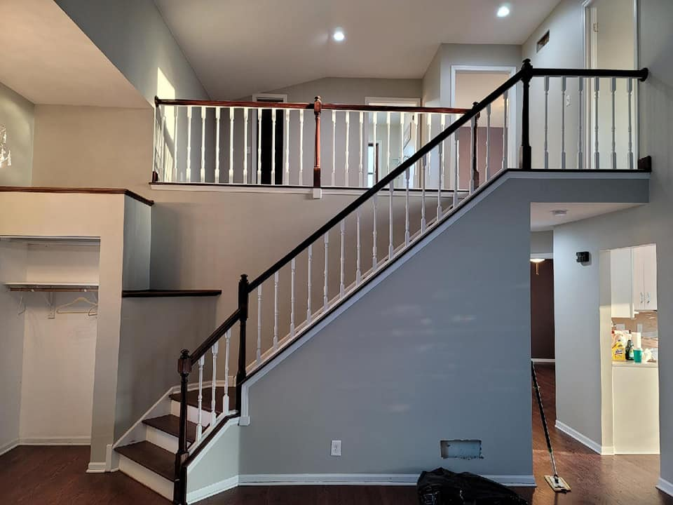 Image of remodeled living space with stair case